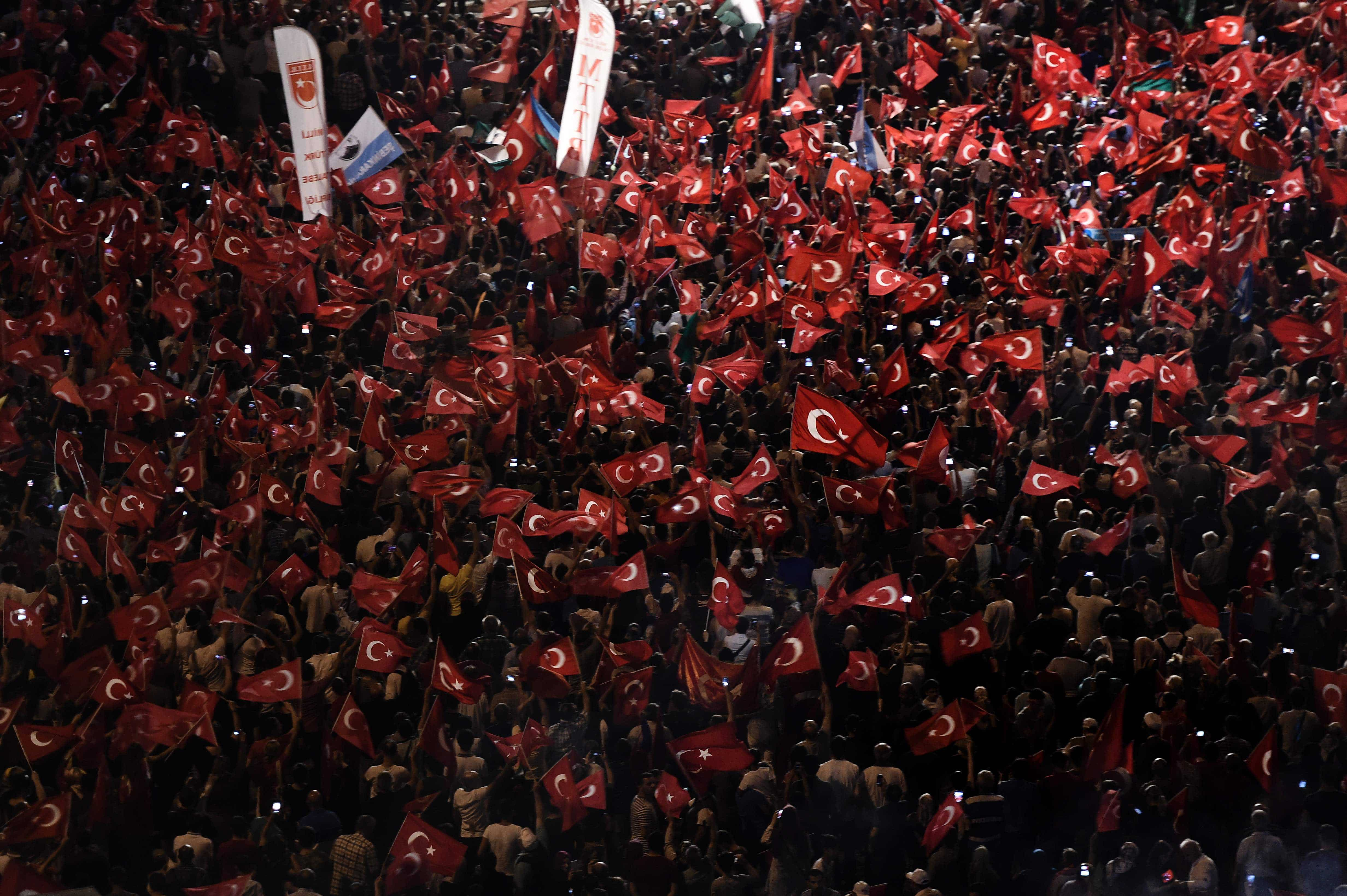 LKS 20160719 ARIS2230; A Pro-Erdogan supporters hold Turkish national flags during a rally at Taksim square in Istanbul on July 18, 2016 following the military failed coup attempt of July 15. Turkish security forces on July 18 carried out new raids against suspected plotters of the botched coup against the rule of President Recep Tayyip Erdogan, as international concern grew over the scale of the crackdown. Thousands of pro-Erdogan supporters waving Turkish flags filled the main Kizilay Square in Ankara while similar scenes were seen in Taksim Square in Istanbul, AFP photographers said. / AFP / ARIS MESSINIS - LEHTIKUVA / AFP